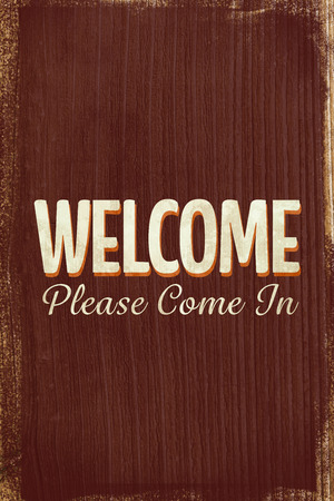 come in: A Vintage welcome sign saying come in Stock Photo