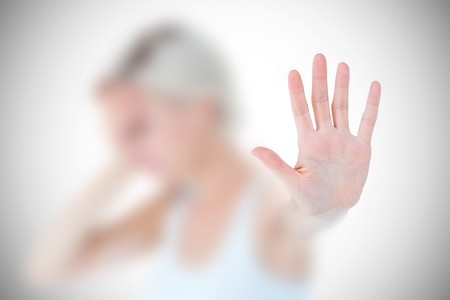 dreariness: Sad blonde holding her hand  against white background with vignette