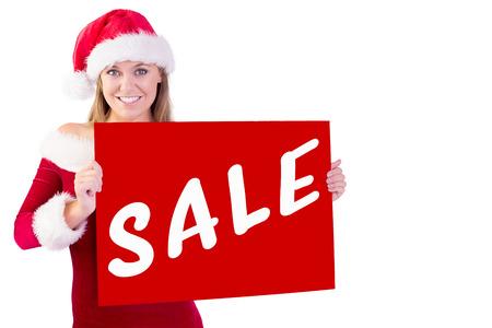 pere noel sexy: blond Festive souriant � la cam�ra tenant l'affiche contre la vente advertisement