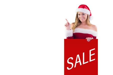 pere noel sexy: Festive blonds souriant et pointant contre la vente publicit�