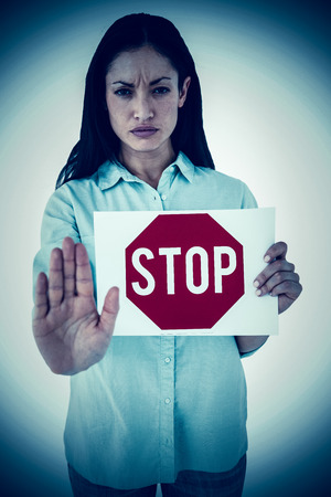 red hand: Woman showing card and saying stop against stop sign
