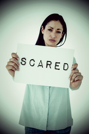 long depression: Sad woman showing sign against scared