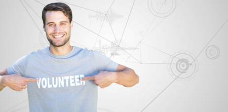 volunteer point: Happy volunteer in the park against interface with graphs Stock Photo