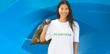 against abstract: Team of volunteers picking up litter in park against abstract blue design Stock Photo