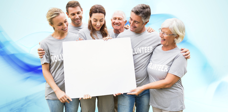 Happy volunteer family holding a blank  against blue abstract design