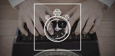 introducing: Digital image of stopwatch against man working on typewriter at table in office