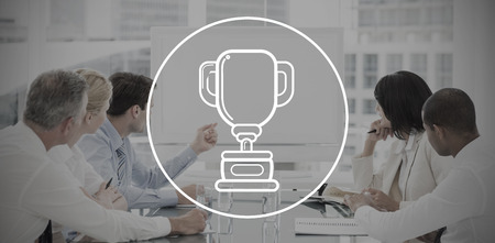 award background: winners cup against business people looking at blank whiteboard in conference room Stock Photo