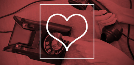 old phone: Heart against parts of hands using old phone