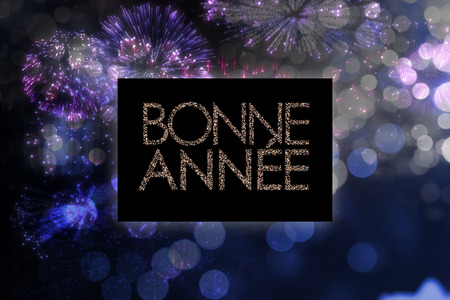 bonne: Glittering bonne annee against colourful fireworks exploding on black background Stock Photo