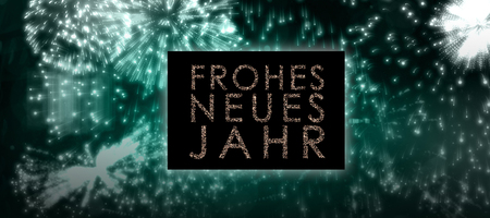 jahr: Glittering frohes neues jahr against colourful fireworks exploding on black background Stock Photo