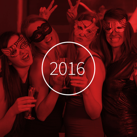 hedonism: Attractive women wearing masks holding champagne against new year graphic Stock Photo