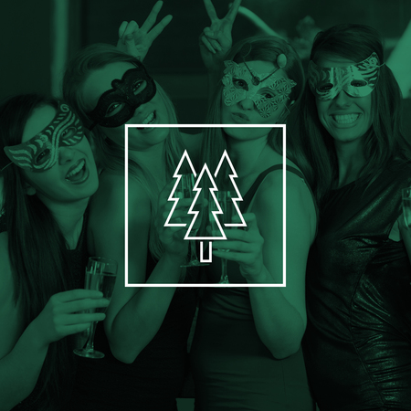 hedonism: Attractive women wearing masks holding champagne against christmas trees Stock Photo