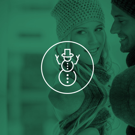 hedonistic: Couple in warm clothing hugging against snowman