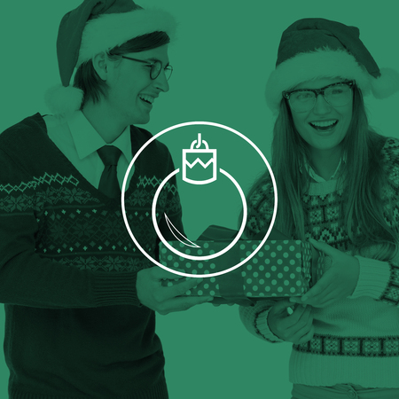 geeky: Geeky hipster couple holding present  against bauble Stock Photo