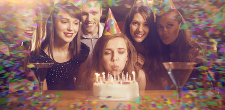 hedonism: Colour frame against friends celebrating a birthday together Stock Photo