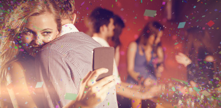 couple dancing: Flying colours against cute couple slow dancing together