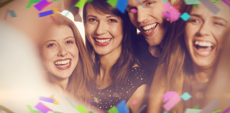 hedonistic: Flying colours against drunk friends laughing with barman Stock Photo