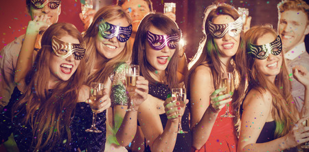 masquerade: Flying colours against friends in masquerade masks drinking champagne