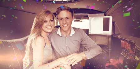 hedonistic: Flying colours against happy couple smiling in limousine