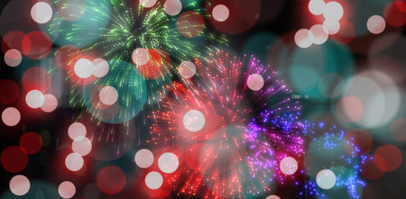 arms outstretched: Digitally generated colourful fireworks exploding on black background
