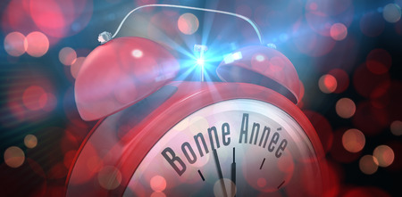 bonne: Bonne annee in red alarm clock against red glowing dots on black Stock Photo