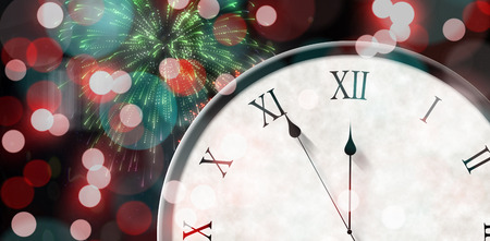 numeral: Roman numeral clock counting down against colourful fireworks exploding on black background Stock Photo