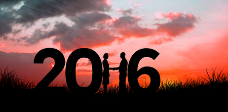 red sky: Silhouettes shaking hands against red sky over grass Stock Photo