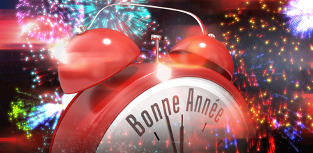 bonne: Bonne annee in red alarm clock against colourful fireworks exploding on black background