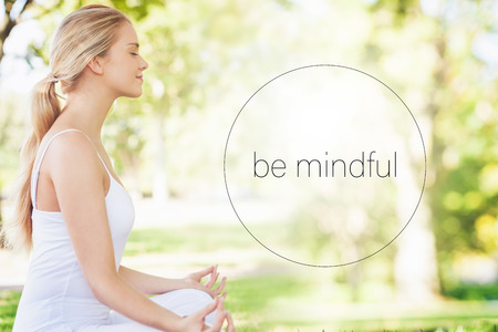 Mid section of calm young woman meditating  against motivational new years message