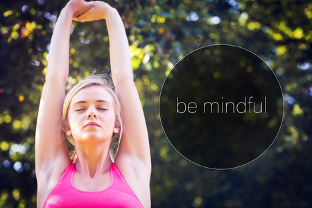 Motivational new years message against active relaxed blonde doing yoga exercise Stock Photo
