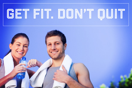 Motivational new years message against happy sporty couple photo