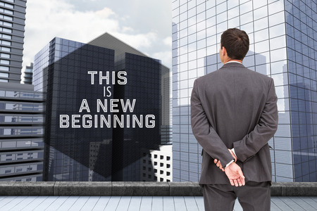 hands behind back: Motivational new years message against businessman standing with hands behind back