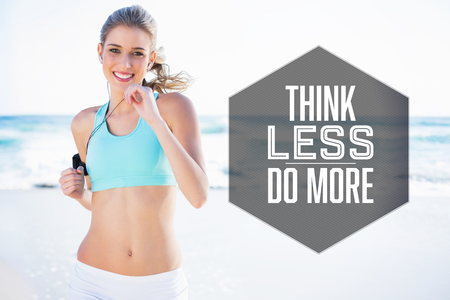 Motivational new years message against sporty blonde jogging on the beach