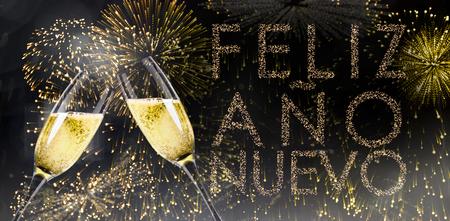 nuevo: Champagne glasses clinking against glittering feliz ano nuevo