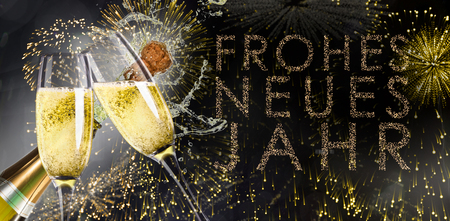 neues: Champagne popping against glittering frohes neues jahr