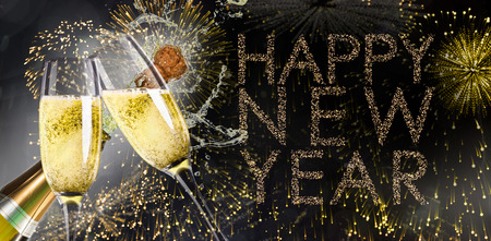 popping: Champagne popping against glittering happy new year