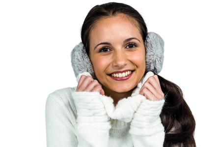 Earmuffs: Attractive woman with earmuffs on white screen