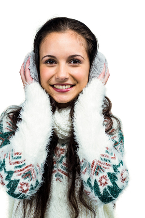 Earmuffs: Smiling woman with earmuffs on white screen Stock Photo