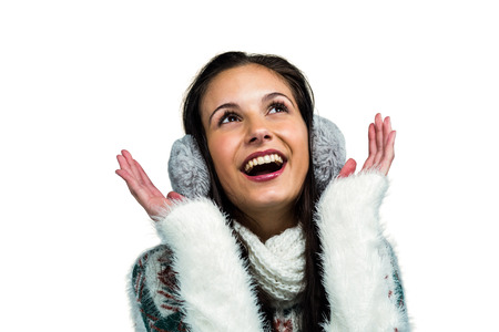 Earmuffs: Smiling woman with earmuffs looking up on white screen