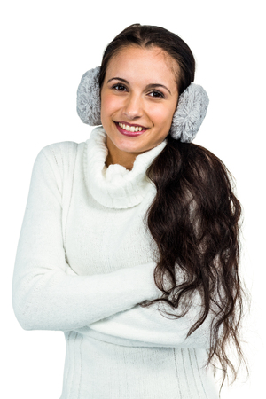 Earmuffs: Smiling woman with earmuffs crossing arms on white screen