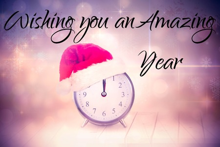 against the clock: New years greeting against christmas clock