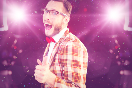 party poppers: Geeky hipster pointing at camera against flying colours