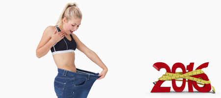 body concern: Young thin woman wearing old pants after losing weight against white background with vignette