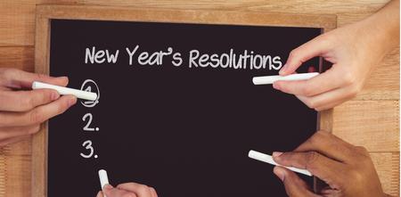 new years resolution: New years resolution list against hands writing on chalkboard Stock Photo