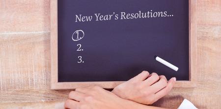 new years resolution: New years resolution list against hand writing on chalkboard Stock Photo