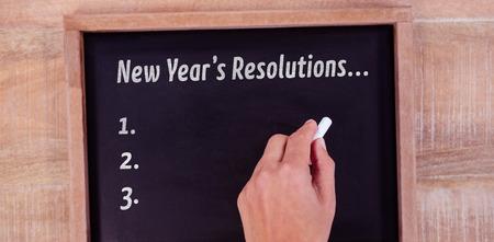 new years resolution: New years resolution list against view of hand writing on blackboard Stock Photo