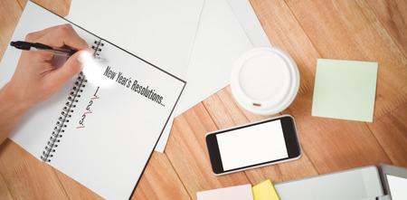 new years resolution: New years resolution list against businessman writing on spiral notebook