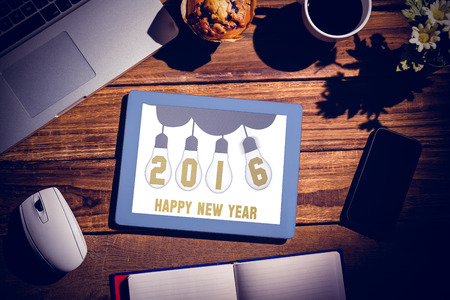 books on a wooden surface: Happy New Year against view of a desk