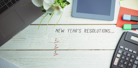new years resolution: New years resolution list against overhead view of an desk
