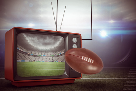 old fashioned tv: american football against rugby stadium Stock Photo